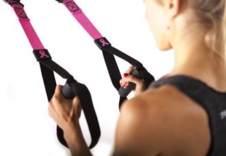 Wer den TRX Suspension Trainer in pink kauft, spendet 10% des Kaufpreises